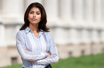 YOung woman standing in front of courthouse columns