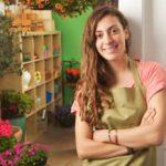 Teenage female working in a flower shop