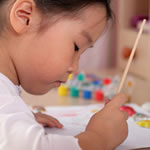 Young girl having difficulty painting displaying symptoms of Visual Perception/Visual Motor Deficit disorder.