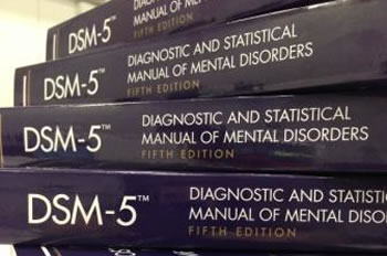 Stack of DSM-5 Manuals