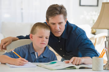 Father correcting son's homework