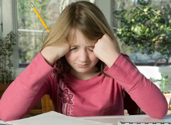 Ffrustrated student doing difficult homework assignment