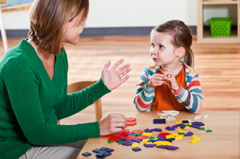 Professional therapist working with a young student