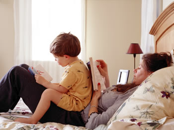 Mother and young son share reading time together at home.