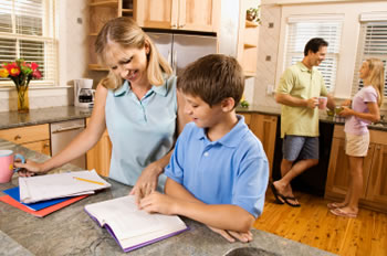 Parents assisting son with homework