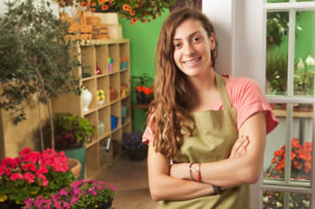 Teenage female working in a flower shop