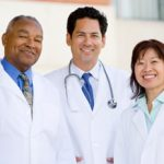 Three physicians standing together