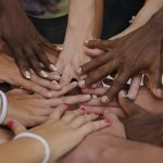 Many hands supporting each other image