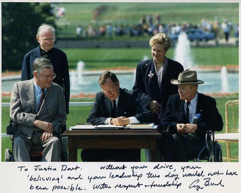 George H.W. Bush signing the ADA